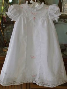 Adylynn's dress and slip. Dress is sheer Bearissima Batiste and slip is Martha's Favorite batiste.  Pattern is Old Fashioned Baby's Antique T-Yoke Christening Dress - Gown length.  Laces from MPC.  Anchor Floss: 48, 73, 120, 1042 and DMC 3716. Made by Diane Jensen