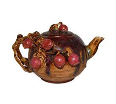 Majolica-like Teapot Draped with Red Pomegranate Fruit by RoyalPalmAntiques on Etsy https://www.etsy.com/listing/108869005/majolica-like-teapot-draped-with-red