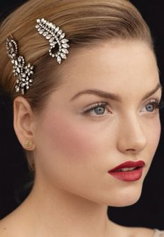 CLELIA. She would wear a darker lip shade than Tansy, and sharper brows