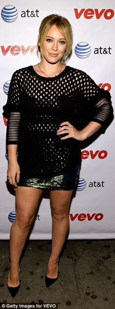 Textured frock: The star wore a black long sleeve mini dress that put on her long legs on display