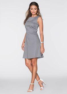 5b5c5993e6 Nőies ruha pöttyös mintázattal. Deréktől lefelé enyhén bővülő  szabásvonallal. Cipzárral a hátoldalán. Hossza a 42-es méretben kb. 96 cm.