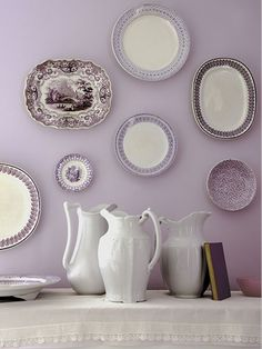 Got a mishmash of heirloom plates in the attic? Dust 'em off and create a colorful wall accent by hanging them together. Disc hanger for plates up to 12 inches, about $6; joann.com