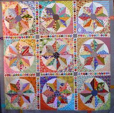 "Scrappy Windmills quilt by Chris Jurd. Patchwork Fundamentals: 2014 Bloggers Quilt Festival. There are 72 blades in all these blocks and a massive 168 x 1"" hexagons."