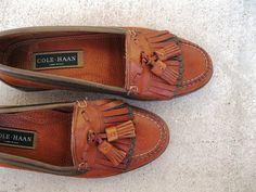 Classic vintage loafers by Cole Haan!    Brown leather loafer, with a leather sole, featuring a double kilte (fringe) and tassles, contrasting peppled
