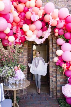 It all started with a colour palette of pale pink, tangerine and raspberry.. The trick to adding more interest to this look is to mix and match the balloons in with other materials, so I added a variety of pink and tangerine coloured paper lanterns, honeycomb balls, pom poms and paper garlands; this will create depth and texture with the different sizes.