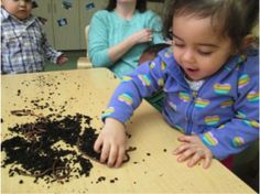 Pre-K students in Lincoln, Nebraska, play with, and learn about, earthworms. (Courtesy of Educare.)