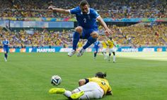 Greece's Giannis Maniatis leaps over a challenge by Colombia's Mario Yepes.