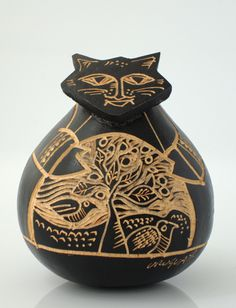 Uruguayan folk art. I dont  like the expression folk art, however I love this gourd transformed in a pussy cat!