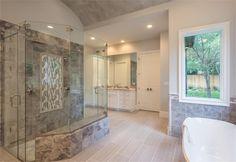 11926 Broken Bough Dr Bunker Hill, TX 77024: Photo View of the master bathroom looking toward his vanity.