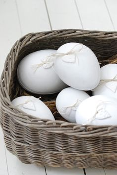 lovely and simple: take real eggs and decorate with white string and a daisy cut-out - or I'll try delicate resh flowers like feverfew. And I'll use Pritt to make it stick
