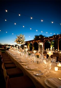 Low-slung lights, candles and lots of translucent details create an outdoor tablescape that glows in the desert night at @Four Seasons Resort Scottsdale at Troon North.