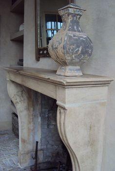 Chimney with antique vase