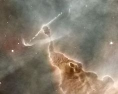 This pillar of gas and dust, located in the Carina Nebula, is slowly being destroyed by a highly active star located near the top of the pillar by constantly ejecting high-energy particles. Want more astronomy? Head over to astronomyforamateurs.com for more!