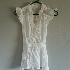 Adorable blouse! White blouse with lace and eyelet detail, ties in the back. Mine Tops Blouses