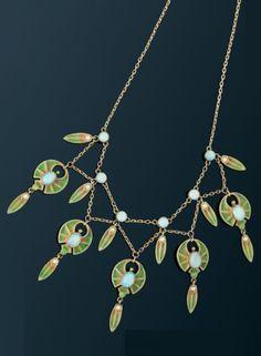 An Art Nouveau plique-à-jour enamel, cabochon opal and pearl necklace. #ArtNouveau #necklace