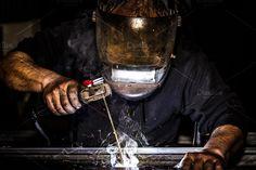 Mask protected welder man welding metal - Close up portrait view of professional mask protected welder man welding metal and sparks metal. Miller Welding Helmet, Retirement Invitation Template, Metal Welding, Close Up Portraits, Creative Photography, Metal Art, Photoshoot, Steel, Industrial