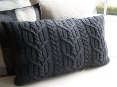 Upcycled cable knit sweater pillow cover.
