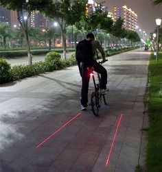 Stop getting hit by cars and trucks while you foolishly decide to ride a bike on poorly lit roads, now you can create your own visible bike lane with this.