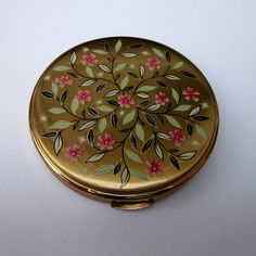 I am a fan of vintage compact mirrors.