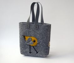This is a natural gray color beautiful bag for little girls. It is made of industrial wool felt.  The bag has a yelow bird on the top.  Bag Size: 20cm x