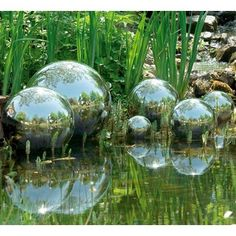 I love these silver balls, especially when they are floating in a pool. so chic.  Blomus Polished Bola Garden Globe Set