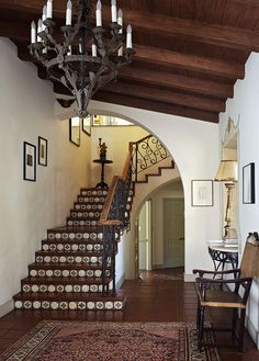 staircase w/ spanish tile risers + iron railing