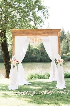 Gorgeous draped fabric ceremony arbor: http://www.stylemepretty.com/oregon-weddings/cave-junction/2015/12/22/romantic-gold-blush-riverside-wedding/ | Photography: Olivia Leigh - http://olivialeighphotoart.com/