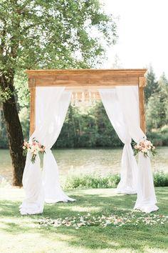 Gorgeous draped fabric ceremony arbor: http://www.stylemepretty.com/oregon-weddings/cave-junction/2015/12/22/romantic-gold-blush-riverside-wedding/ | Photography: Olivia Leigh - http://olivialeighphotoart.com/