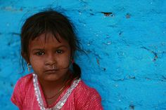 Pink on Blue | Sparkling in red at the slum in Kochrab. | Meena Kadri | Flickr