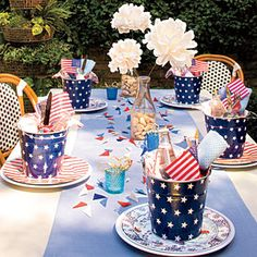 An All-American Table Setting | Table Setting | SouthernLiving.com - Use the buckets to hold all the things your guest will need for the evening such as flatware, napkins, flag favors, handi-wipes for BBQ sauce removal and even a mint or two.
