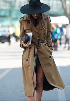 This combo of a brown trench and a black sweater dress gives off a very casual and approachable vibe.  Shop this look for $182:  http://lookastic.com/women/looks/black-hat-brown-trenchcoat-black-clutch-black-sweater-dress/7743  — Black Wool Hat  — Brown Trenchcoat  — Black Leather Clutch  — Black Sweater Dress