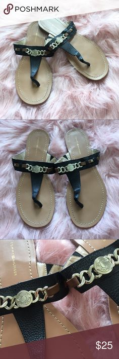 Tommy Hilfiger Black Gold Chain Thong Sandals Thing style Sandals, Tommy Hilfiger brand, gently used great condition, only signs of wear are on bottom, gold accented logo chain, faux leather band, size 8 true to size, open to offers Tommy Hilfiger Shoes Sandals