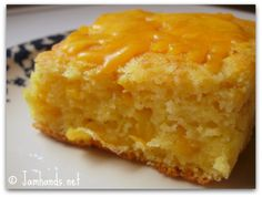 Cheesy Cornbread Supreme YUMMY, THAT IS ONE WORD TO DESCRIBE THIS BREAD. SO GO WITH CHEESE MELTING THROUGH THE BREAD. SERVE IT WARM AND EVERYONE WILL WANT MORE...ENJOY