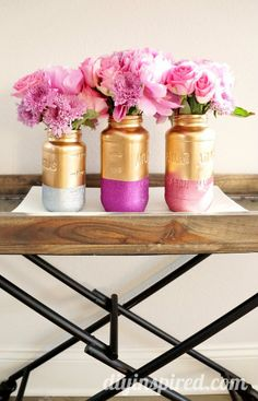 DIY gold and glittered mason jar centerpieces for a gorgeous wedding.