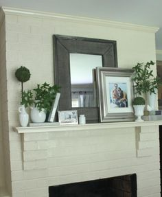 simplicity of the mantle decor (layers of frames / plants / candles / lighting)
