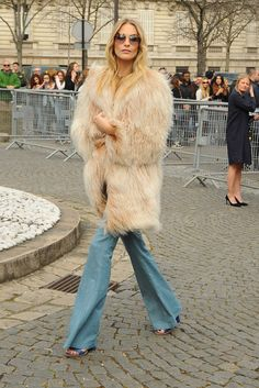 Poppy Delevingne, Chloë Sevigny and other celebs rock fur, fringe and flared denim for a 70s revival.