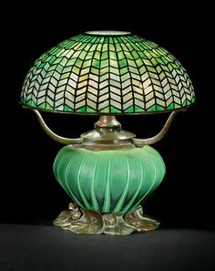 A Leaded Glass and Bronze Tiffany Table Lamp with blown glass base c. 1905