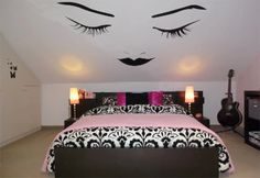 Using eye decals is a great way to use up a small, crunched space. The bedding is wonderful too!