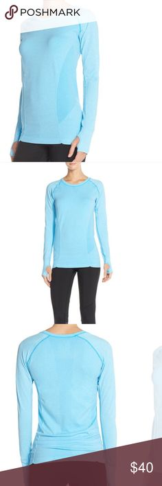 Zella Top💙 Zella seamless crewneck long sleeve tee. Has thumb holes in the cuffs of both sides to keep your hands warm and stop your sleeves from creeping up while your working out. 54% Nylon, 40% Polyester, 6% Spandex. Worn a few times, great condition!                       •n o  t r a d e s• •s m o k e  f r e e / p e t  f r e e  h o m e•   •s a m e / n e x t  d a y  s h i p p i n g• Zella Tops Tees - Long Sleeve