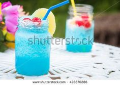 Blue Cocktail Drink with cherries and pineapple