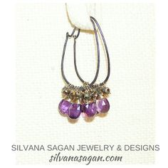 Amethyst & Pyrite Clusters Hoops wrapped in gold & dangle from oxidized sterling silver.