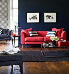 navy wall + coral sofa. Never in a million years would I imagine I would like these colors, but I DO! Master bedroom, or kids family room re-do.  (Too dark for walls when skylights gone?)