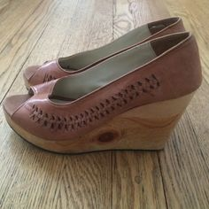 Urban Outfitters wood wedges. Worn twice UO wood peep-toe wedges. Only worn twice. Small stain on right shoe toe area. See pic. Urban Outfitters Shoes
