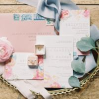 NEED this wedding invitation! the floral and gold...