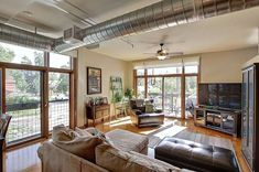 Exposed ductwork works in this loft space! Industrial Interior Design, Industrial Interiors, Small Apartment Design, Small Apartments, Home Living Room, Living Spaces, Barn Kitchen, Highland Homes, Apartment Projects