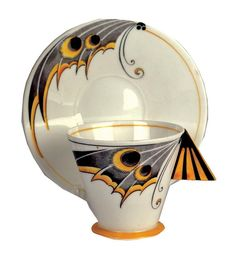 An Art Deco Shelley moth-wing cup and saucer, decorated in bright yellow and black colour-way