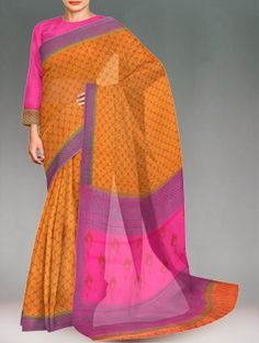 Shop online designer pure rajasthani kota cotton saree at unnatisilks.com Brown color pure handloom Rajasthani Kota cotton saree with matching blouse.This cotton sari has got all over orange block prints along with blue block printed purple border on either side.And it has block printed purple elegant pallu.It is suitable for casual and corporate wear. To purchase online Kota cotton sarees please visit our site http://www.unnatisilks.com/