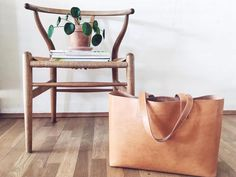 Leather by Hand is a Danish leather design brand defined by Craftmanship, Quality and Minimalism. All products are made by hand in Aarhus.