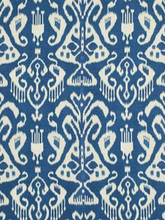 Ikat Upholstery Fabric in peacock blue and ivory. A mid-weight woven fabric suitable for upholstery, throw pillows and headboards. See other