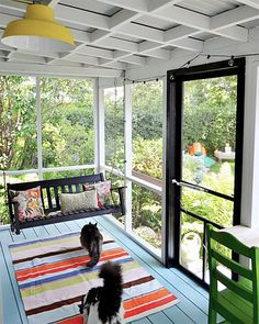 12 serene screened porches - Colorful charm A simple screened-in porch can have big impact with a little color. This small space uses painted floors and furniture, colorful textiles, and a bright yellow lamp to create a relaxing home retreat with a great view of the backyard.
